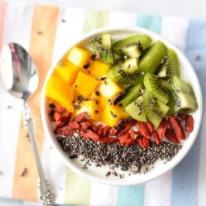 This quick & easy to make Immune Boosting Tropical Breakfast Bowl is packed with nutrition from immune boosting superfoods that are high in vitamins, minerals & antioxidants and good-for-you probiotics.