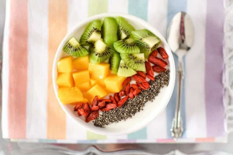 This quick & easy to make Immune Boosting Tropical Breakfast Bowl is packed with nutrition from immune boosting superfoods that are high in vitamins, minerals & antioxidants and good-for-you probiotocs.