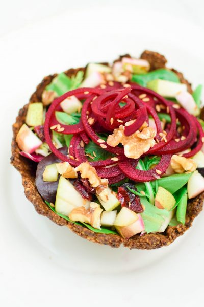 Enjoy a refreshing, plant-based beet and pear salad inside an Edible Walnut Shell Bowl made with California Walnuts! #ad