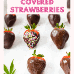 A baking sheet topped with parchment paper topped with several cannabis chocolate covered strawberries