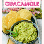 A blue bowl filled with guacamole garnished with a cannabis leaf paired with round tortilla chips