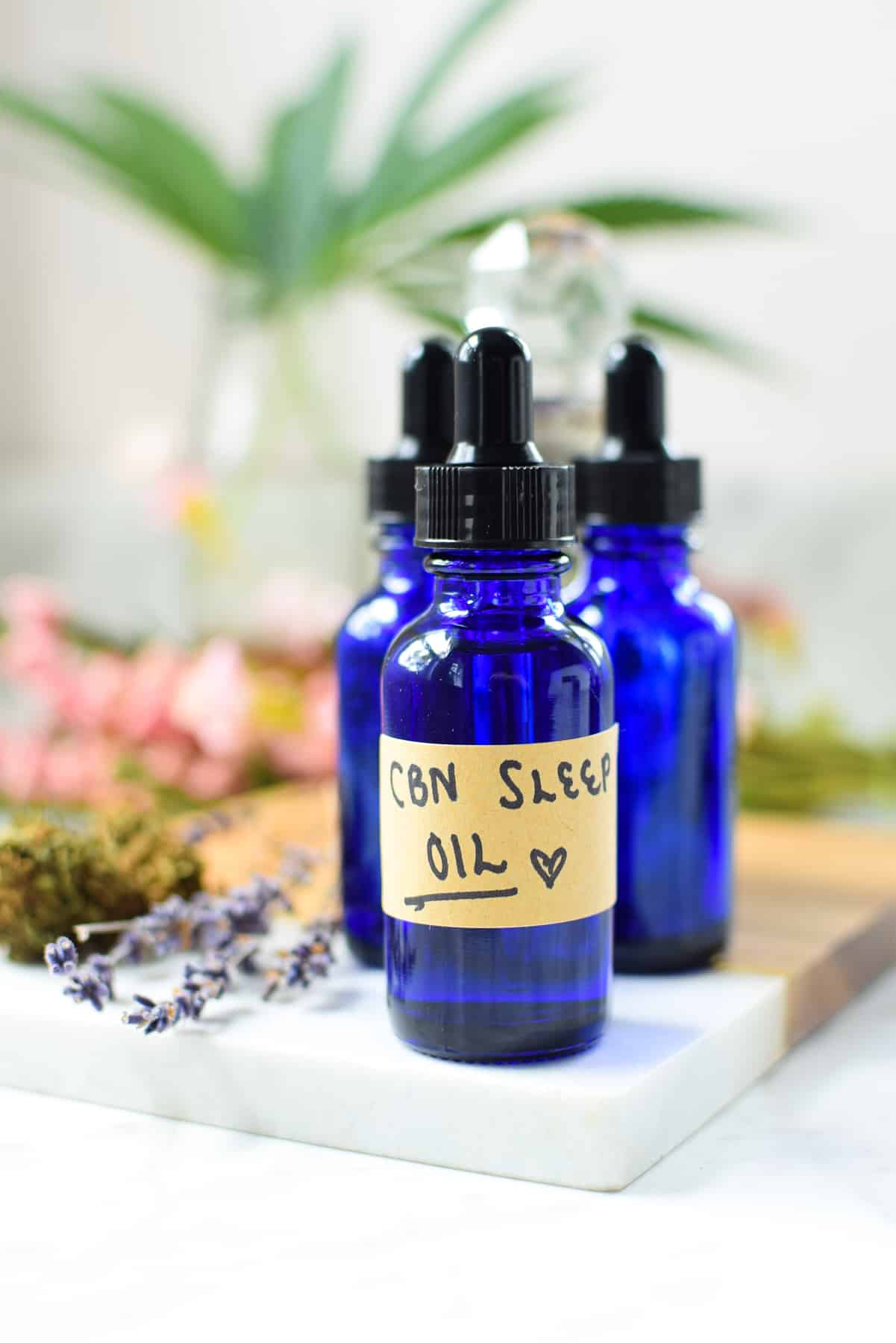 A finished blue bottle of homemade CBN Sleep Oil
